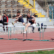 Boys on the 110 meters hurdles race — Stock Photo