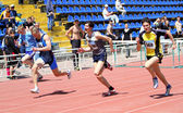 Boys on the finish of the 110 meters hurdles race — Stock Photo