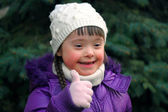 Portrait of young girl giving thumbs up — Stock Photo