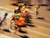 Girls ran out from the start (motion blur). — Stock Photo