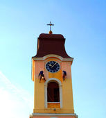 The tower of church with a clock and who paint — Stock Photo