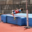Stock Photo: Boy compete in high jump.