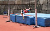 Boy compete in the high jump. — Foto de Stock