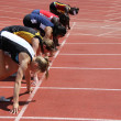 Stock Photo: Girls on start of 100 meters dash