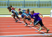 Boys on the start of the 100 meters dash. — Stock Photo