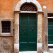 Exterior of the typical old door in Rome, Italy. - 