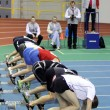 Stock Photo: Boys on start of 60 meters dash