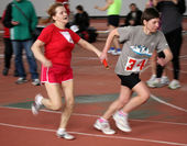 Unidentified women take baton on relay race — Stock Photo