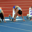 Unidentified girls on the start of the 60 meters dash — Stock Photo #9578701