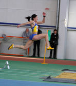 Tsykhotska Ruslana - on the triple jump — Stock Photo
