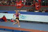 DONETSK,UKRAINE-FEB.11: Kolasa Agnieszka - Polish pole vaulter compete in the pole vault competition with the result 4.40 on Samsung Pole Vault Stars meeting on February 11, 2012 in Donetsk, Ukraine. — Stock Photo