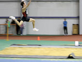 Makarchev Andriy wins second place the long jump — Stock Photo