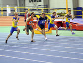 Unidentified men on the finish of the 60 meters dash — Stock Photo