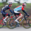 Blured racing cyclists — Stock Photo