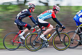 Blured racing cyclists — Stock Photo