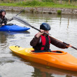 Stock Photo: Kayakers paddling