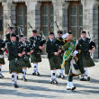 Stock Photo: Pipes band marching