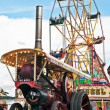 Stock Photo: Steam and fairground wheel