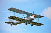 Old vintage biplane in flight — Stock Photo