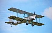 Old vintage biplane in flight — Stock Photo
