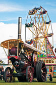 Steam and fairground wheel — Stock Photo