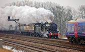 Old steam locomotive on a mainline day trip — Stock Photo