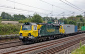 Heavy rail freight loco and containers — Stock Photo