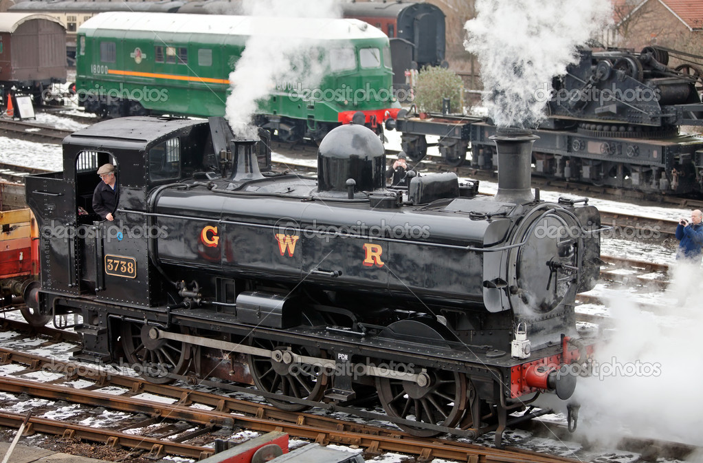DIDCOT, ENGLAND - FEBRUARY 12: Pannier steam engine 3738 pulls a demonstration freight train at the GWR museum's steam running day on February 12, 2012 at Didcot  Stock Photo #9348415