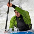 Kayaker in a strong white water rush — Stock Photo