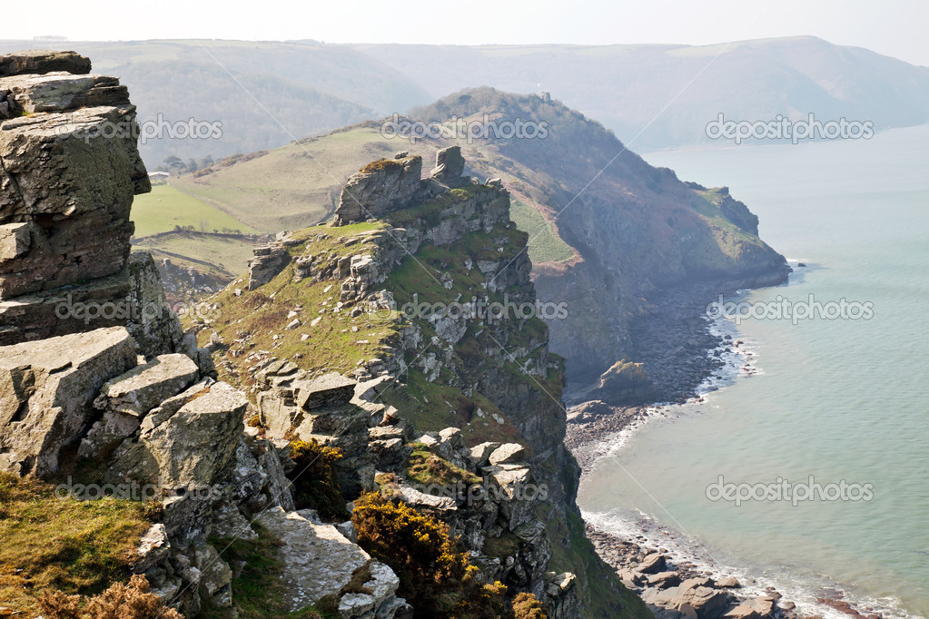 Coastal scene of the Valley of rocks on the northern coast of South West England bathed in a sea mist — Stock Photo #9849065
