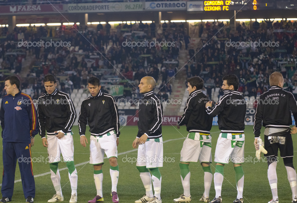 CORDOBA,SPAIN JANUARY 8: Players of Cordoba C.F. in initial alignment during match league Cordoba(W) vs Girona(R)(1-0) at the Municipal Stadium of the Archangel on January 8,2012 in Cordoba Spain   Stock Photo #10025912