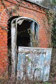 Dilapidated brick building — Stock Photo
