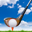 Golf ball and driver on green grass — Stock Photo #8028643
