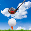 Golf ball and driver on green grass — Stock Photo #8028651