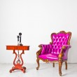 Vintage luxury armchair and telephone in white room — Stock Photo #8029503