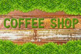 Green grass coffee shop word on wood background — Stock Photo