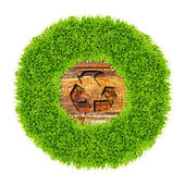 Recycle sign and green grass on wood background — Stock Photo