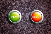 Play and reset button on grunge texture — Stock Photo