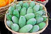 Green mango in bamboo basket — Stock Photo