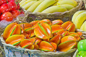 Pile of star fruits in bamboo basket — Stock Photo