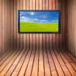 Wide screen television in wooden room — Stock Photo