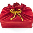 图库照片: Red fabric gift bag isolated