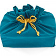 图库照片: Blue fabric gift bag isolated
