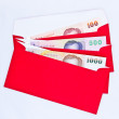 Money in red envelope for give to on chinese new year — Stock Photo
