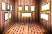 Golden wood frame in wooden room — Stock Photo