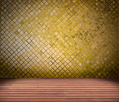 Golden mosaic wall and wood floor — Stock Photo