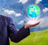 Earth globe in hand — Stock Photo
