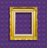 Frame of golden wood on the wallpaper — Stock Photo