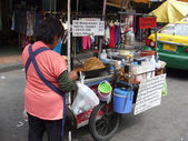 Thai street food seller — Stock Photo