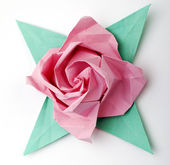 Origami a pink rose — Stock Photo